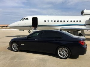 A BMW and a private jet
