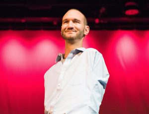 Nick Vujicic speaking publicly on stage