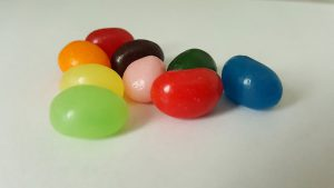 Nine different coloured jelly beans