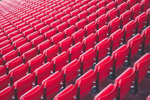 A stadium stand with red seats