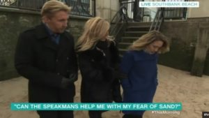 The Speakmans helping a lady with a fear of sand