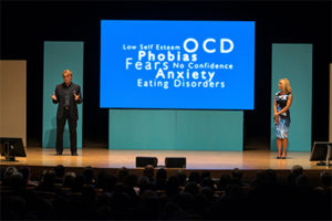 The Speakmans speaking on stage at one of their events